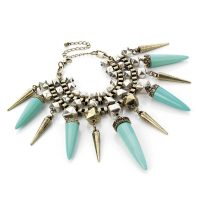 Brushed silver colour Tribal effect bracelet with turquoise tooth shaped beads