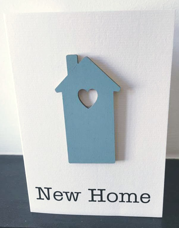 new home - blue wooden house card