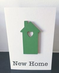 new home - green wooden house card