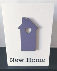 new home - purple wooden house card