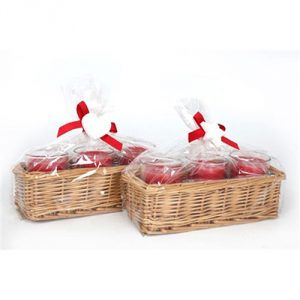Christmas red candles in a wicker basket