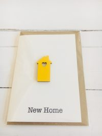 New Home card - yellow wooden house with cut out heart - Sartorial Boutique and Gifts